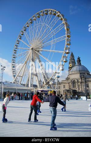 Winter Wonderland Ice Skating rink with Big Wheel, City Hall Gardens, Cardiff, Wales, United Kingdom - Stock Photo