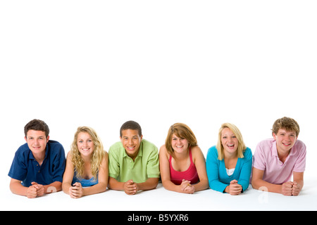 Teenagers Lying Down In A Row - Stock Photo