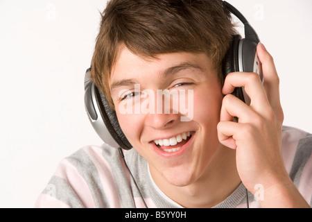 Teenage Boy Listening To Music On Headphones - Stock Photo