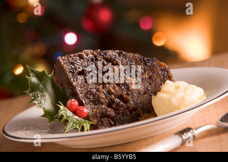 Portion of Christmas Pudding with Brandy Butter - Stock Photo