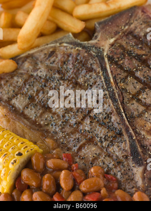 T-Bone Steak with Fries Corn and Beans - Stock Photo