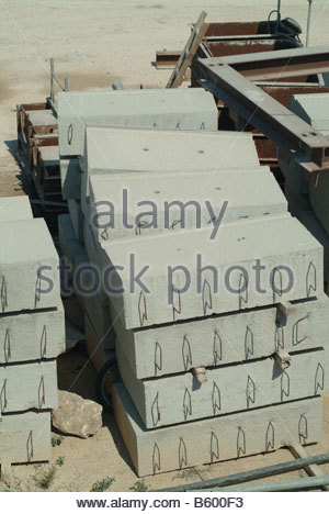 Construction building Large Concrete blocks with rebar poking out sticking reinforced CINDER - Stock Photo