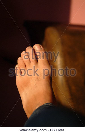 Foot of a man male bare skin feet toes sunlight sunny daylight CLOSE UP - Stock Photo