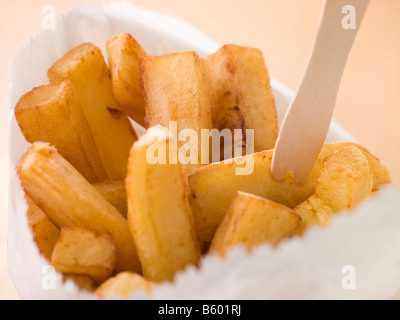 Chip Shop Chips in a Bag with a Wooden Fork - Stock Photo