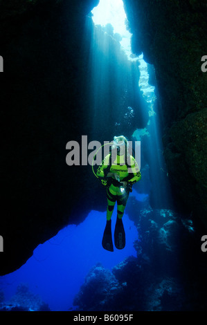 grot grotto scuba diver in cave with light reflexes, Red Sea - Stock Photo
