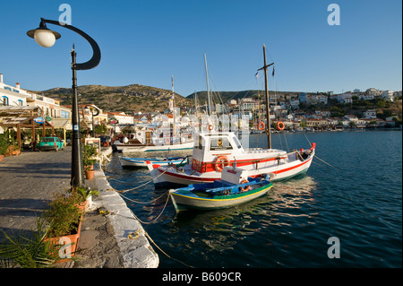 Small fisherman boats in a sunny and picturesque harbour. - Stock Photo