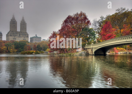 Bow bridge in Autumn on cold misty day - Stock Photo