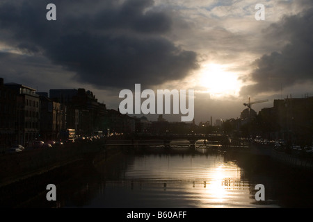 View of the Millennium bridge over The River Liffey in Dublin city centre Ireland at sunset - Stock Photo