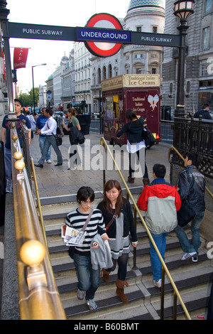 People entering and exiting the London Underground metro system in the city of London England - Stock Photo