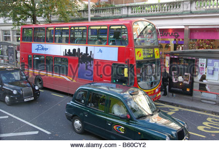 London bus red buses Buses and black TAXI cab English England British Great Britain - Stock Photo