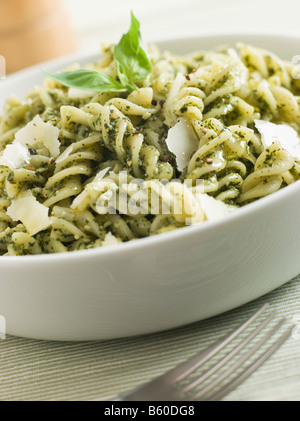 Bowl of Fusilli Pasta dressed in Pesto with Parmesan Shaves - Stock Photo