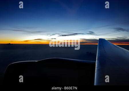 Sunset, view from window of an airplane near Singapore, Singapore, Asia - Stock Photo