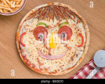 Smiley Faced Pizza with a Portion of Chips - Stock Photo