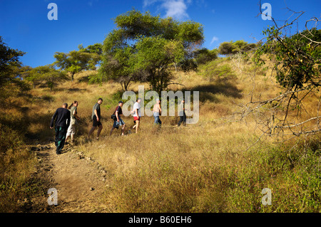 Ranger and tourists walking on a trail, Komodo National Park, World Heritage Site, Komodo, Indonesia, Asia - Stock Photo