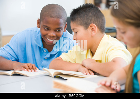 Students in class reading together (selective focus) - Stock Photo