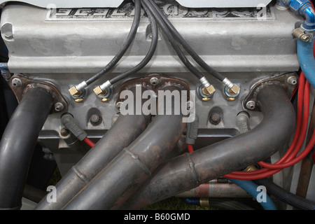 Fuel injection nozzles and exhaust ports on the side of an engine used for speedway racing - Stock Photo
