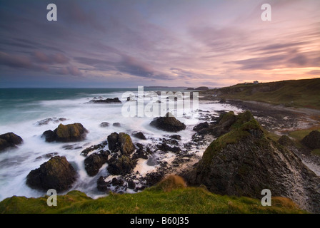 Landscape of stormy seas at sunrise Ballintoy Harbour County Antrim Northern Ireland