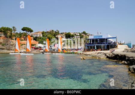 Cala Les Bassetes, beach, bay, restaurant, catering, sailing boats, watersport, school, Calpe, Costa Blanca, Alicante, - Stock Photo