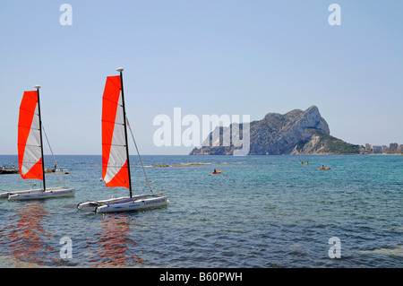 Cala Les Bassetes, beach, bay, sailing boats, watersport, school, mountain, Penon de Ifach, Calpe, Costa Blanca, - Stock Photo