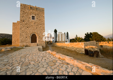 Castle and church in the light of the evening sun on a greek island - Stock Photo