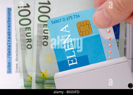 Hand with an employee smart card, ELENA, no original design, cash notes and a salary statement - Stock Photo