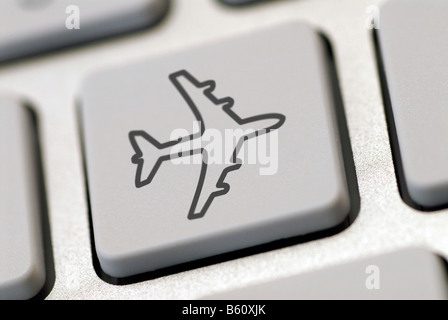 Computer keyboard with an airplane symbol, symbolic image for internet travel bookings - Stock Photo