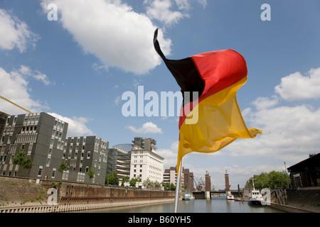 Flag of Germany, basin, Kontorhaus, Schwanentor Bridge, Duisburg, North Rhine-Westphalia - Stock Photo