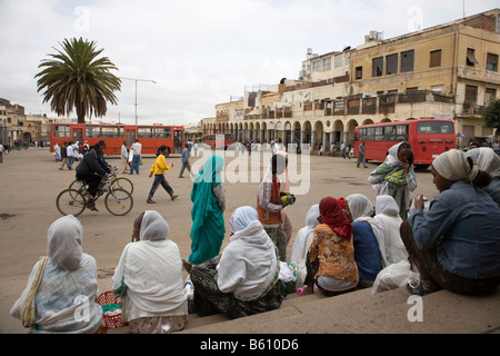 People at a bus staion in the capital, Eritrea Square, Asmara, Eritrea, Horn of Africa, East Africa - Stock Photo