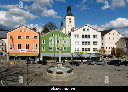 Market Square with fountain in front of the parish church of St Michael, Regen, Bavarian Forest, Lower Bavaria - Stock Photo