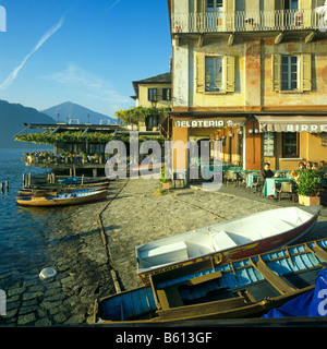 Waterfront with coffee shops, bars and restaurants, Orta San Giulio at Lago dOrta, Lake Orta, Piedmont, Italy, Europe - Stock Photo