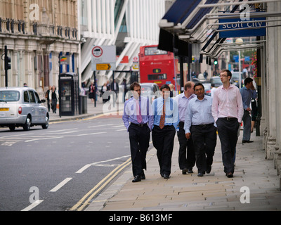 Group of office workers walking the London city streets during lunch break London UK - Stock Photo