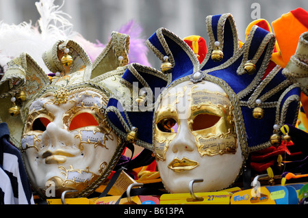 Masks for sale at a booth, Piazza San Marco Square, Venice, Veneto, Italy, Europe - Stock Photo