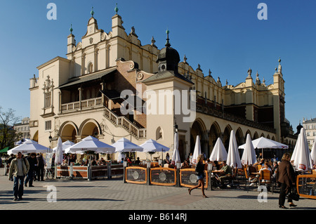 Street cafe in front of the Cloth hall, Sukiennice, in Krakow market square, Rynek, UNESCO World Heritage Site, - Stock Photo