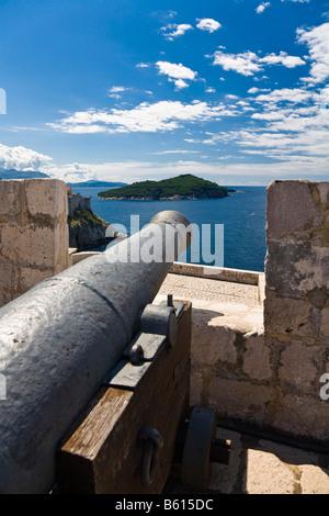 View over an old cannon on Fort Lovrijenac onto Lokrum Island, Dubrovnik-Neretva, Dalmatia, Croatia, Europe - Stock Photo