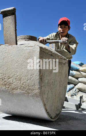 Child labour, 14 year old boy grinding stone containing ore, tin, zinc, to a fine powder, Llallagua mining centre, - Stock Photo