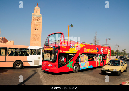 Double-decker open-top tourist bus in front of the Koutoubia Mosque, Marrakech, Morocco, Africa - Stock Photo