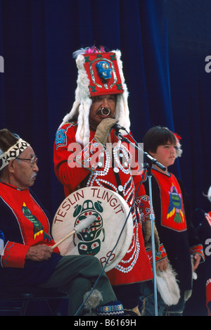 Native American Tlingit Indian Family celebrating at a Pow Wow in Traditional Ceremonial Regalia Dress - Stock Photo