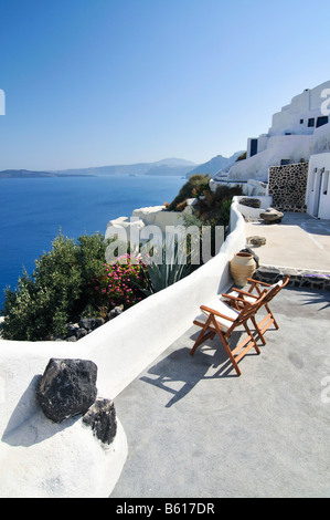 Terrace of a small hotel with a view over the blue sea, Thira, Fira, Santorini, Cyclades, Greece, Europe - Stock Photo