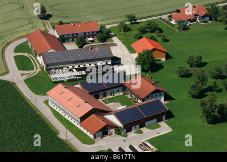 Photovoltaic installation on the roofs of square shaped farms, Muehldorf, Upper Bavaria - Stock Photo