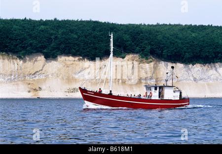 Cutter Alexander with tourists in front of chalk cliffs, Baltic Sea, Ruegen Island, Mecklenburg-Western Pomerania - Stock Photo