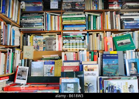 Corner full of antique books in an antiquarian bookshop - Stock Photo