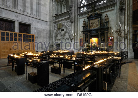 Sacrificial lights at the altar of the decorated Madonna, Cologne cathedral, North Rhine-Westphalia - Stock Photo