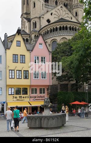 Market square in the Martinsviertel Quarter, Great St. Martin Church at back, Cologne, North Rhine-Westphalia - Stock Photo