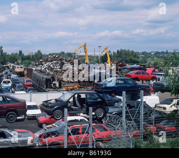 View of a scrap metal collection point, car chassis, pile of metal rubbish - Stock Photo