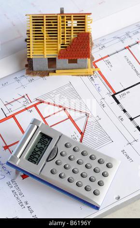 Blueprints houses and calculator stock photo 88921888 for Blueprint estimator