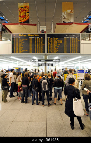 Passengers waiting in queues at check-in counters, Stuttgart Airport, Baden-Wuerttemberg - Stock Photo