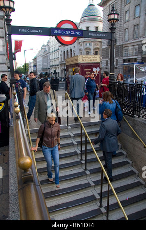 People entering and exiting the London Underground transit system in the city of London England - Stock Photo