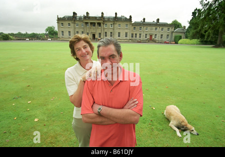 Lord and Lady Palmer their butler and Manderston House their home - Stock Photo