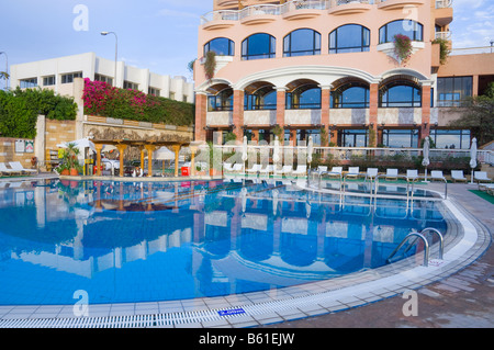 The swimming pool area of the Hotel Sonesta St George in Luxor Egypt - Stock Photo