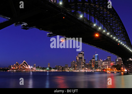 Sydney skyline with the Harbour Bridge, Opera House and Central Business District at sunrise, Sydney, Australia - Stock Photo